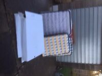 4 Single fold up beds with mattresses, 2 only used once and boxed