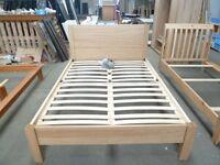 Double bed in light oak finish