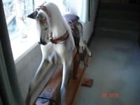 Antique rocking horse, three feet four inches high by four feet four inches long