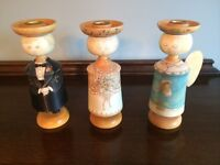 Candle holders; 3 hand-carved