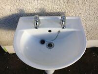 White ceramic sink and taps