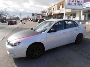 2010 Subaru Impreza Pearl White AWD Upgraded package  116,000km