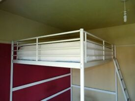 Cream coloured steel loft style double bed.