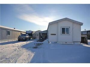 ~OWNED LOT IN CLAIRMONT WITH MOBILE & DETACHED 18X28 GARAGE~
