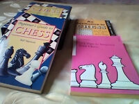 Chess set in new condition with accompanying book and 2 other chess books