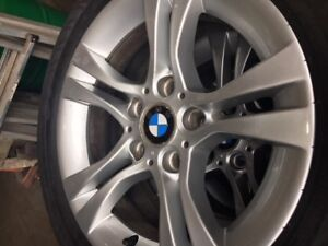 SET OF BMW RIMS, CENTER CAPS AND TIRES.