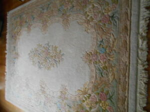 Pastel Floral area carpet. 8.5 x 11