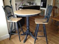 Round Table and 2 Swivel high back chairs(Bar Style) from David Phipp
