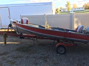 Great used aluminum fishing boat with trailer, 6 hp motor.