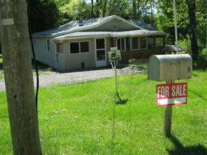 1.87 Acres with cottage and 3 x out buildings - As Is, Where Is
