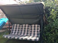 3 SEATER GREEN METAL SWING SEAT FOR SALE WITH CHECK PADDED CUSHIONS.