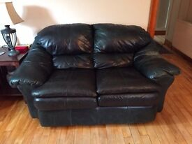 Dark navy leather two seater sofa, arm chair and ottoman for sale. High quality leather.