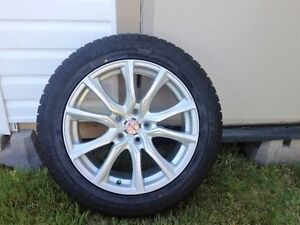 4 Brand new  Winter  tires and new Aluminum rims.