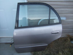 1998-2002 COROLLA LEFT REAR DOOR WITH GLASS