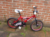 Huffy Ignite boys bike in red, 15 inch diameter wheels, in good condition