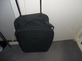 small black luggage suit case