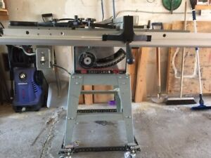 Craftsman 10in Table Saw on wheeled base.