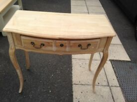 Occasional table in 'limed oak'.