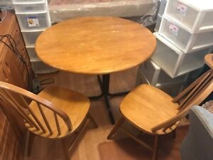 Wooden dining table w/ four  matching chairs