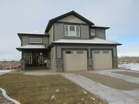 5406-43rd St in Taber's Westview Estates backing onto lake.
