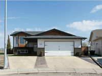 LOCATION! LOCATION!FANTASTIC COULEE VIEW WITH 4 BEDROOMS, 3 BATH