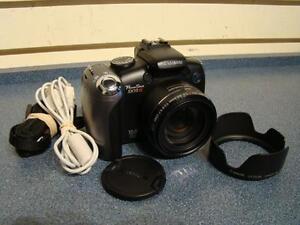 Canon. Appareil photo numerique.-- 453731