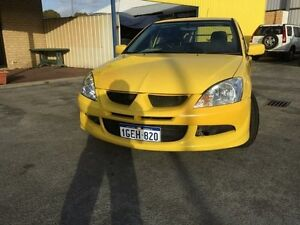 2004 Mitsubishi Lancer CH LS Sedan 4dr Man 5sp 2.0i Yellow Manual Sedan Maddington Gosnells Area Preview