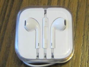 Apple Earbuds and Apple Charging Cube