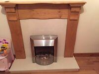 Oak fireplace, cream granite surround & base. Electric fire included