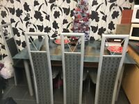Glass Top Grey Dining Table & 4 Chairs