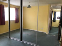 Bedroom mirror fronted sliding wardrobes - shelves -
