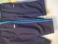 2 PAIRS CUT-OFFS- SLAZENGER AND LONSDALE - Approx 13yrs