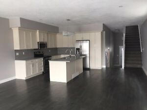 Brand new 4 bdrm / 3.5 bath half-duplex for rent