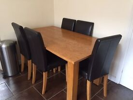 Dinning table with 6 chairs for sale, moving to new house. Needs to be picked up