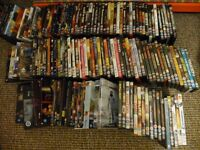 JOB LOT OF DVDS IN CASES IN TWO BIG BAGS FULL