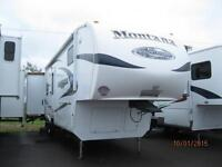 WOW!  Montana 32' Fifth Wheel with 3 Slides, Rear Living.!!