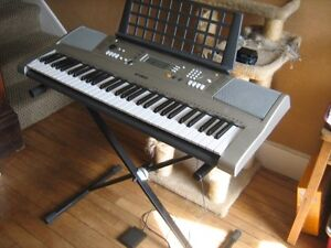 Yamaha's E-Series keyboard  PSRE313 with stool and foot pedal