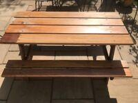 Substantial solid Iroko hardwood picnic bench