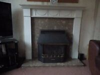 Valor balanced flue coal effect gas fire with brown/pink marble hearth & surround with white mantle.