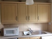 Used KitcheN Cupboards with some appliances