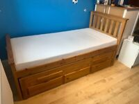 Two comfortable beds in one space saving design with storage drawers