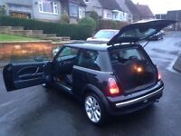 Mini Cooper . 10 months MOT , receipts for £2450 for work done . Drives , looks really well