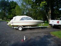 70 hhp evinrude on fiberglass boat and trailer with cover