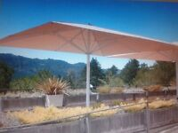 Giant umbrella parasol repairs and service. Uhlmann & other brands.