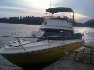 Up for sale or trade is my 24 foot Sea-Ray Sedan Bridge Boat and