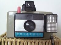 1960's Polaroid Swinger 11 Land Camera complete with flash unit
