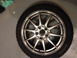 WINTER TIRES AND 10 SPOKE ALLOY RIMS