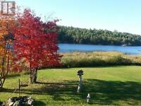 FURTHER REDUCED!!! Low Taxes!!! Waterfront Oasis!