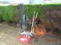Five sea fishing rods and reels with two rod carry bag and box.