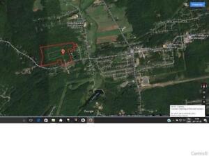 Terre de plus de 2 000 000p2 situé à Bellefeuille. Beau secteur